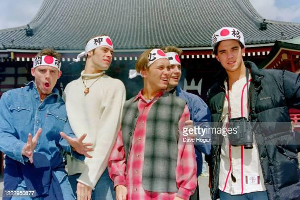 Mark Owen, Howard Donald, Gary Barlow, Robbie Williams and Jason Orange of Take That wearing headbands in Tokyo, March 1993