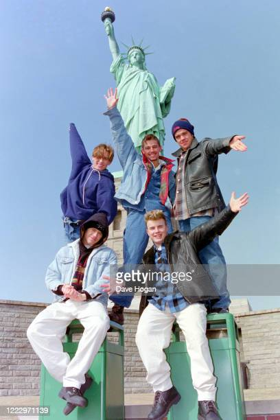 Mark Owen, Howard Donald, Gary Barlow, Robbie Williams and Jason Orange of Take That visit the Statue of Liberty in New York, 1995