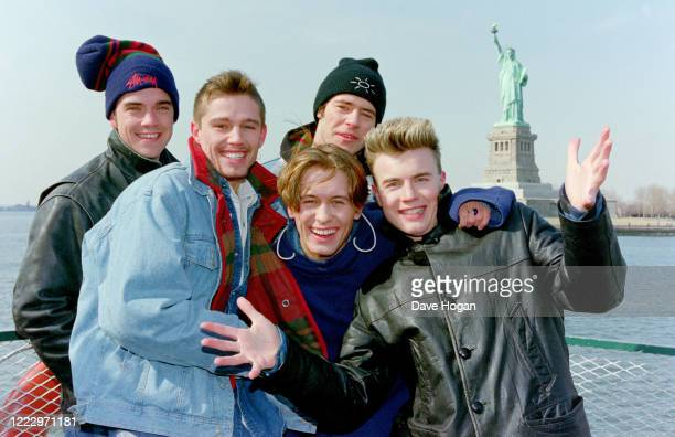 Mark Owen Howard Donald Gary Barlow Robbie Williams and Jason Orange of Take That visit the Statue of Liberty in New York 1995