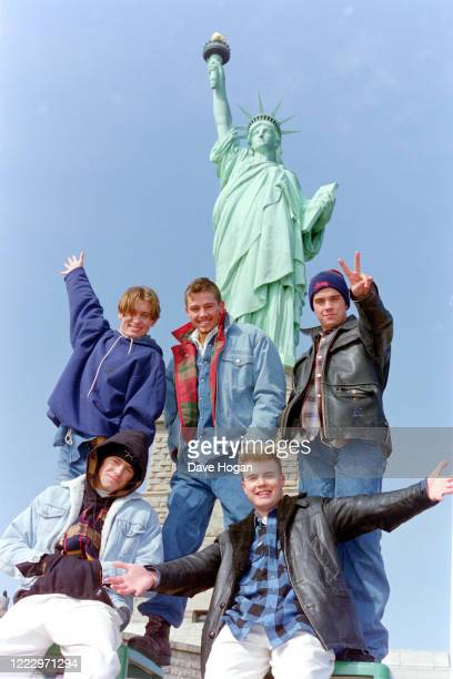 Mark Owen, Howard Donald, Gary Barlow, Robbie Williams and Jason Orange of Take That visit the Statue of Liberty in New York 1995