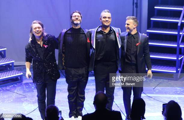"""Mark Owen, Howard Donald, Robbie Williams and Gary Barlow of Take That perform at the Opening Night Gala of """"The Band"""" to benefit the Elton John AIDS..."""