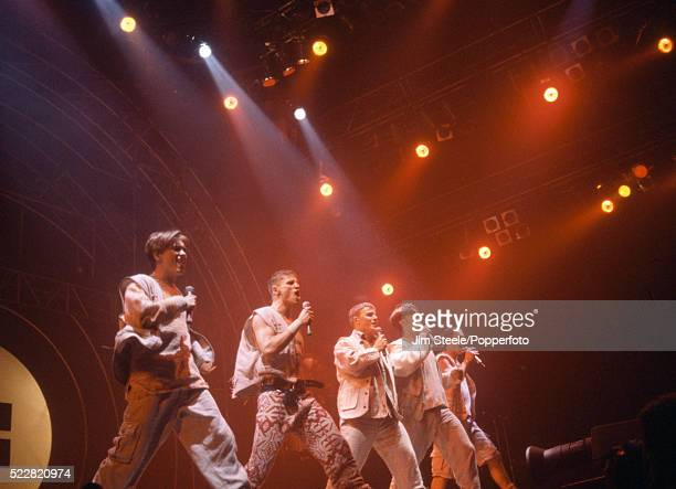 Mark Owen Jason Orange Gary Barlow Robbie Williams and Howard Donald of Take That performing on stage at the Wembley Arena in London circa July 1993