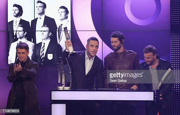 Mark Owen Robbie Williams Howard Donald and Gary Barlow of Take That receive their International Band Rock/Pop Award at the Echo Awards 2011 at...