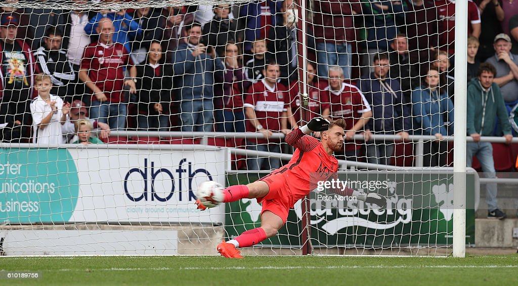 Mark Oxley of Southend United dives in vain as he is beaten by a penalty taken by Alex Revell of Northampton Town for Northampton's second goal during the Sky Bet League One match between Northampton Town and Southend United at Sixfields on September 24, 2016 in Northampton, England.