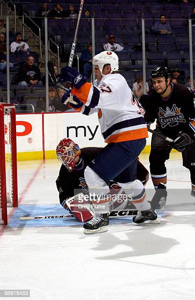 Mark Parrish of the New York Islanders celebrates scoring a goal against goalie Brent Johnson of the Washington Capitals during the third period at...