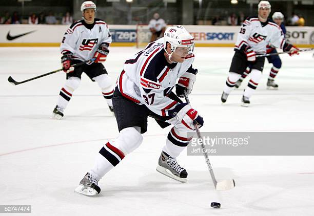 Mark Parrish of the USA controls the puck against Slovenia in the IIHF World Men's Championships preliminary round game at the Olympic Hall on May 1,...