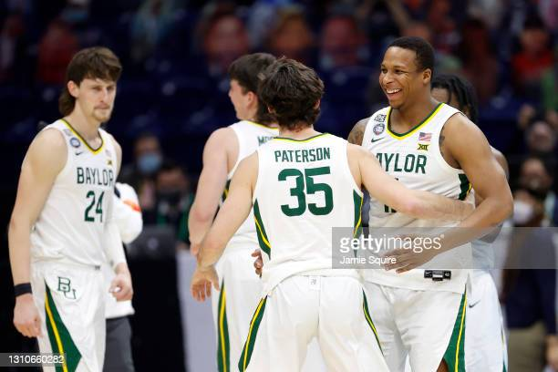 Mark Paterson of the Baylor Bears celebrates with teammates in the final seconds prior to defeating the Houston Cougars 78-59 in the 2021 NCAA Final...