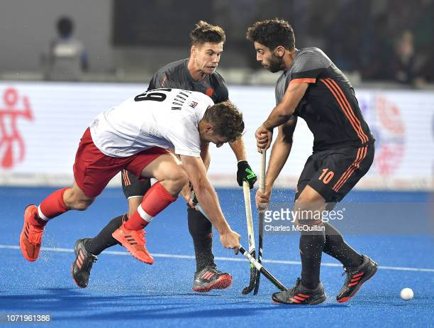 Mark Pearson of Canada is challenged by Valentin Verga of the Netherlands during the FIH Men's Hockey World Cup Crossover match between Netherlands...