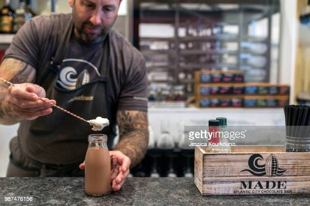 Mark Pellegrino coowner of the new Made Atlantic City Chocolate Bar makes a signature cocktail a chocolate milk martini on June 29 2018 in Atlantic...