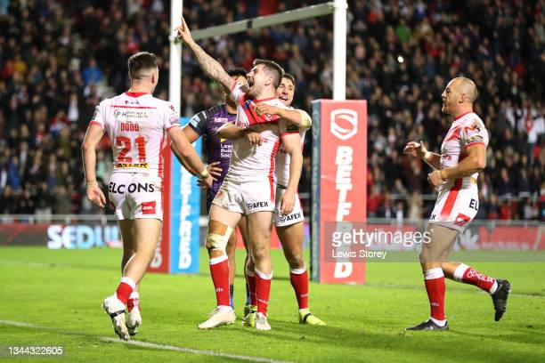 Mark Percival of St Helens celebrates with team mates after scoring their side's fifth try during the Betfred Super League Play-Off Semi Final match...