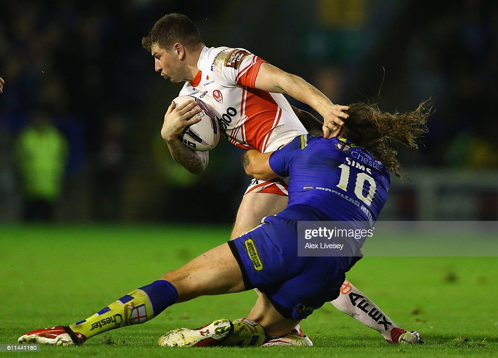 Mark Percival of St Helens is tackled by Ashton Sims of Warrington Wolves during the First Utility Super League Semi Final match between Warrington Wolves and St Helens at The Halliwell Jones Stadium on September 29, 2016 in Warrington, England.