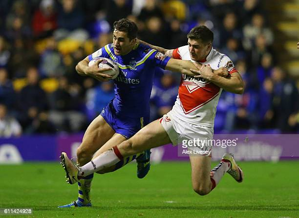 Mark Percival of St Helens tackles Toby King of Warrington Wolves during the First Utility Super League Semi Final match between Warrington Wolves...