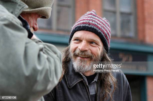 Mark Perry a peer coach at Amistad right smiles as he speaks with Mark left Friday April 21 2017 in Portland Maine as he walks around downtown as...