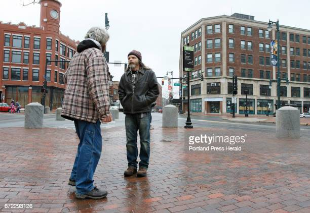 Mark Perry a peer coach at Amistad right speaks with Billy left Friday April 21 2017 in Portland Maine as he walks around downtown as part of his...