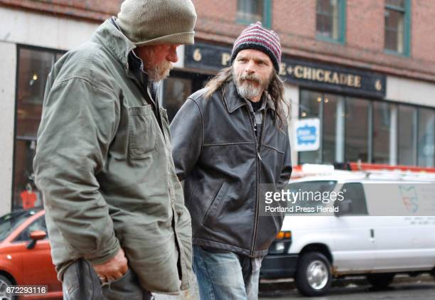 Mark Perry a peer coach at Amistad right speaks with Mark left Friday April 21 2017 in Portland Maine as he walks around downtown as part of his...