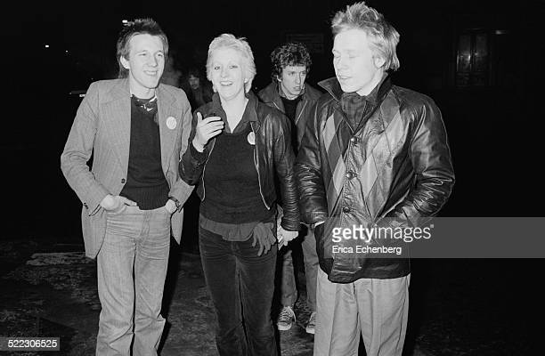 Mark Perry of Sniffin' Glue and punk fan Suzi with Paul Cook and Steve Jones of the Sex Pistols outside Dingwalls Camden London 30th November 1976...