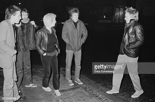 Mark Perry of Sniffin' Glue punk fan Suzi and Nick Jones with Paul Cook and Steve Jones of the Sex Pistols outside Dingwalls Camden London 30th...