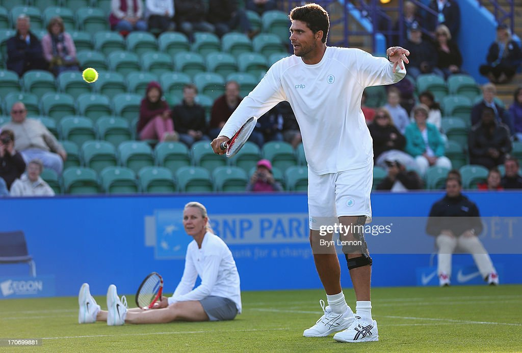 Mark Philippoussis and Rennae Stubbs of Australia in their mixed doubles exhibition legends match against Greg Rusedski of Great Britain and Lindsay Davenport of USA during day two of the AEGON International tennis tournament at Devonshire Park on June 16, 2013 in Eastbourne, England.