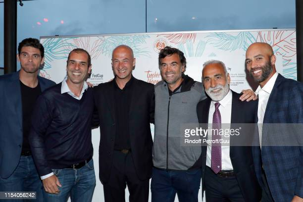 Mark Philippoussis Cedric Pioline Andrei Medvedev Sergi Bruguera Mansour Bahrami and James Blake attend the Legends Of Tennis Dinner as part of 2019...