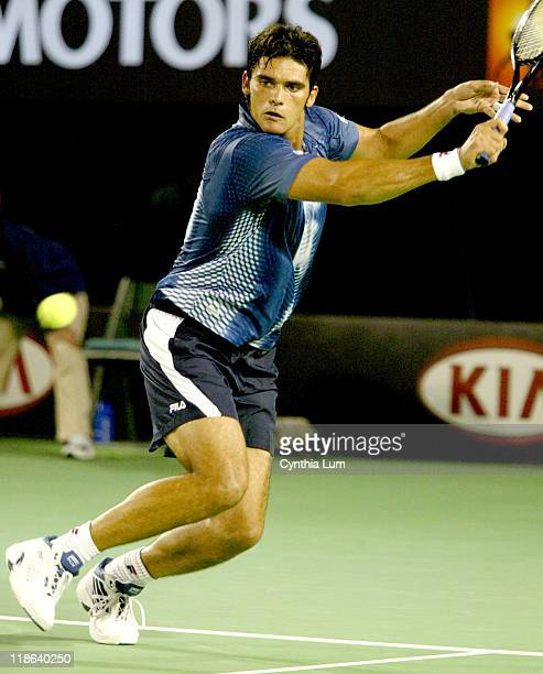 Mark Philippoussis in action against Thomas Johansson in their first round match at the 2004 Australian Open