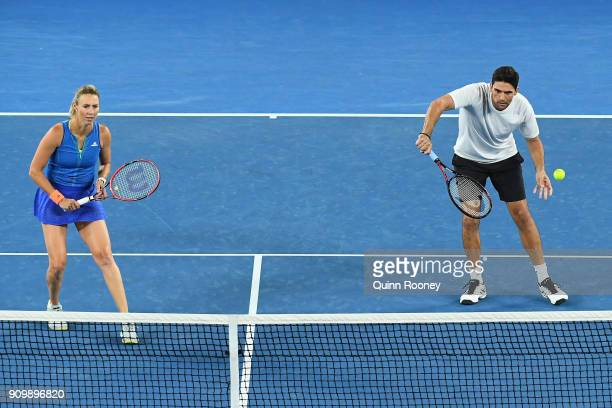 Mark Philippoussis of Australia and Alicia Molik of Australia compete in their Legends Mixed doubles match against Daniela Hantuchova and Goran...