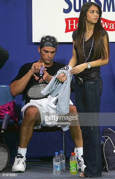 Mark Philippoussis of Australia and his girlfriend Alexis Barbara relax at a training session during the Hopman Cup at the Burswood Dome January 5,...