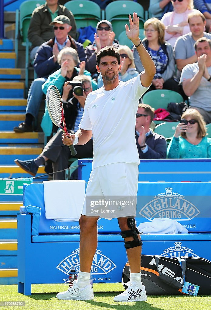 Mark Philippoussis of Australia celebrates victory in his men's singles exhibition legends match against Greg Rusedski of Great Britain during day two of the AEGON International tennis tournament at Devonshire Park on June 16, 2013 in Eastbourne, England.