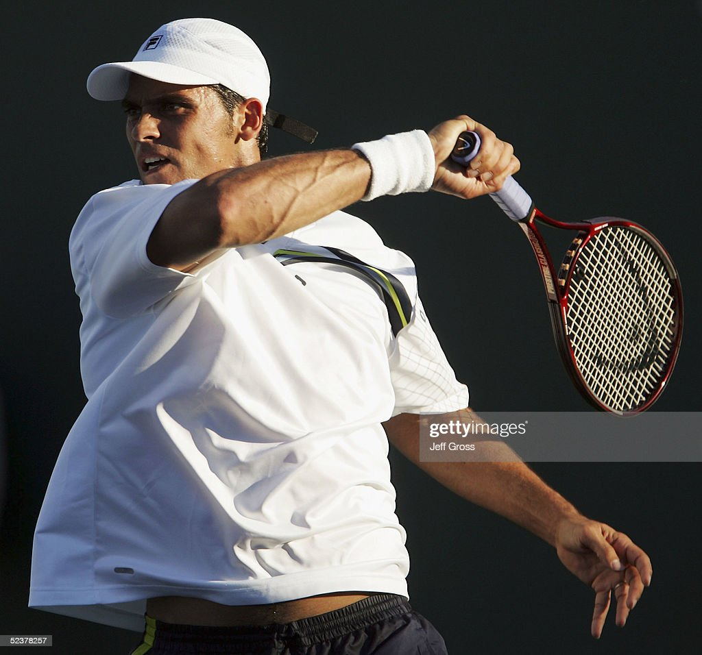 Mark Philippoussis of Australia follows through on a forehand to Gregory Carraz of France during the Pacific Life Open at the Indian Wells Tennis Garden on March 11, 2005 in Indian Wells, California. Carraz defeated Philippoussis 7-6 (7), 6-1.