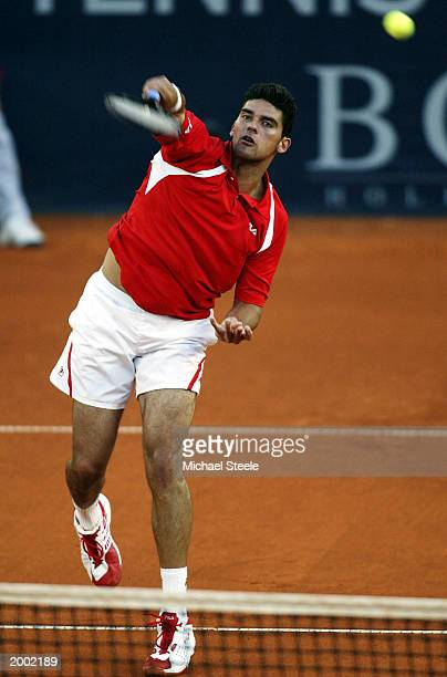 Mark Philippoussis of Australia hits a smash during his third round victory against Roger Federer of Switzerland at the Hamburg Masters Series at the...