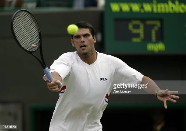 Mark Philippoussis of Australia in action against Alexander Popp of Germany during the men's quarter finals at the Wimbledon Tennis Championships at...