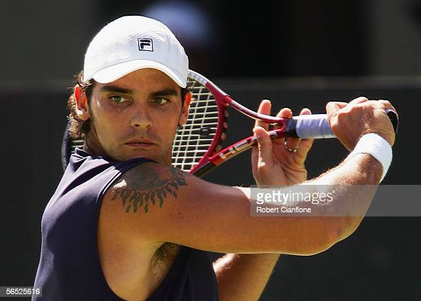 Mark Philippoussis of Australia in action against Dominik Hrbaty of Slovakia on day four of the Next Generation Men's Hardcourts at Memorial Drive on...