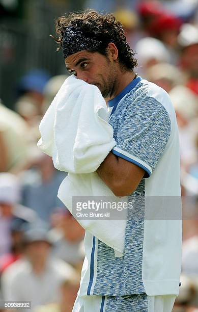 Mark Philippoussis of Australia reacts during his match against Ian Flanagan of Great Britain at the Stella Artois Tennis Tournament at the Queens...