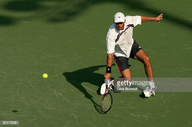 Mark Philippoussis of Australia rolls his ankle as he returns a shot to Christophe Rochus of Belgium during the NASDAQ100 Open at the Crandon Park...