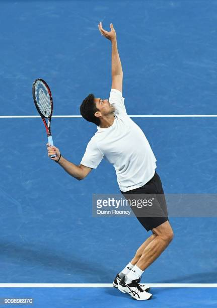 Mark Philippoussis of Australia serves in his match with Alicia Molik of Australia as they compete in their Legends Mixed doubles match against...