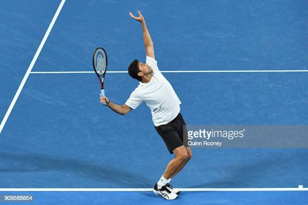 Mark Philippoussis of Australia serves in his mixed doubles match with Alicia Molik of Australia against Goran Ivanisevic of Croatia and Daniela...