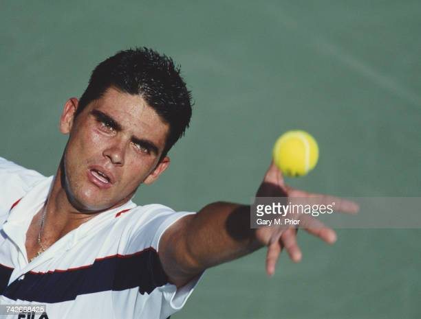 Mark Philippoussis of Australia serves to Albert Portas during their Men's Singles first round match at the US Open Tennis Championship on 30 August...