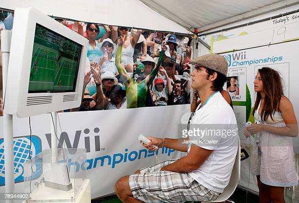 Mark Philippoussis of Australia takes part in the Wii Championships in the Nintendo stand in the FanFest area offcourt on day two of the Australian...