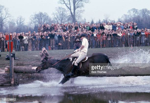 Mark Phillips riding Brazil falls at a water hazard jump during the Badminton Horse Trials, circa May 1978.