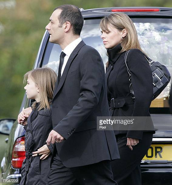 Mark Porcelli, father of Ben Porcelli who was killed in a helicopter crash and family, arrive for the funeral of Colin McRae and son Johnny at East...