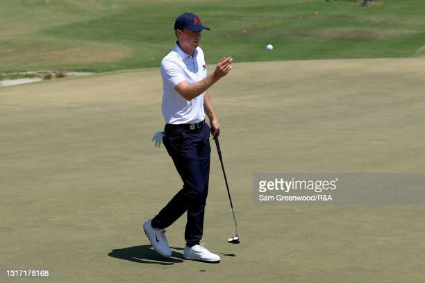 Mark Power of Team Great Britain and Ireland tosses the ball on the 11th green during Sunday singles matches on Day Two of The Walker Cup at Seminole...