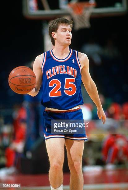 Mark Price of the Cleveland Cavaliers dribbles the ball against the Washington Bullets during an NBA basketball game circa 1990 at the Capital Centre...
