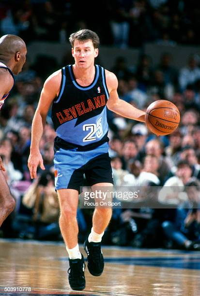 Mark Price of the Cleveland Cavaliers dribbles the ball against the New York Knicks during an NBA basketball game circa 1995 at Madison Square Garden...