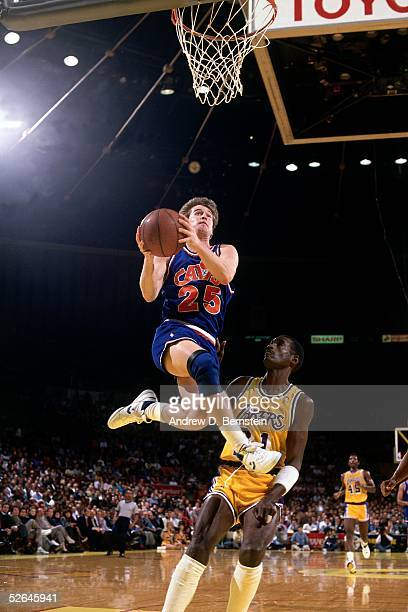 Mark Price of the Cleveland Cavaliers drives to the basket against the Los Angeles Lakers circa 1988 during an NBA game at the Forum in Los Angeles...