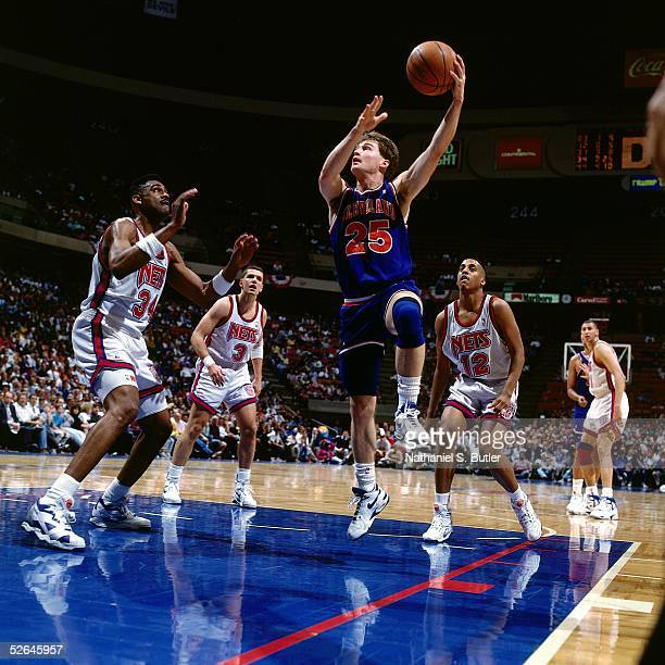 Mark Price of the Cleveland Cavaliers drives to the basket against the New Jersey Nets during an NBA game circa 1991 at the Brendan Bryne Arena in...