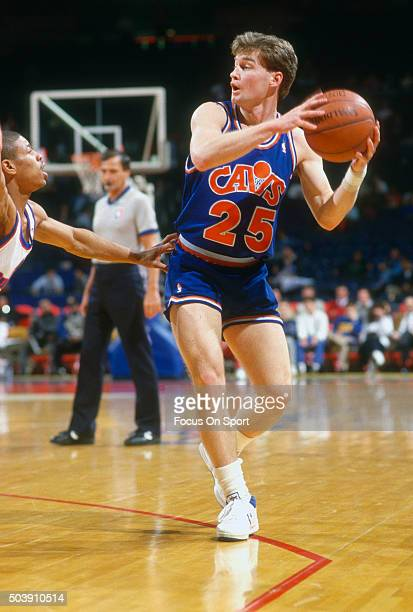 Mark Price of the Cleveland Cavaliers looks to pass the ball against the Washington Bullets during an NBA basketball game circa 1987 at the Capital...