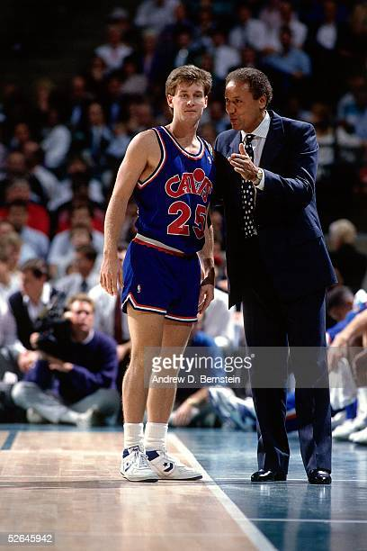 Mark Price of the Cleveland Cavaliers talks with head coach Lenny Wilkens during a break in the action circa 1989 during an NBA game. NOTE TO USER:...
