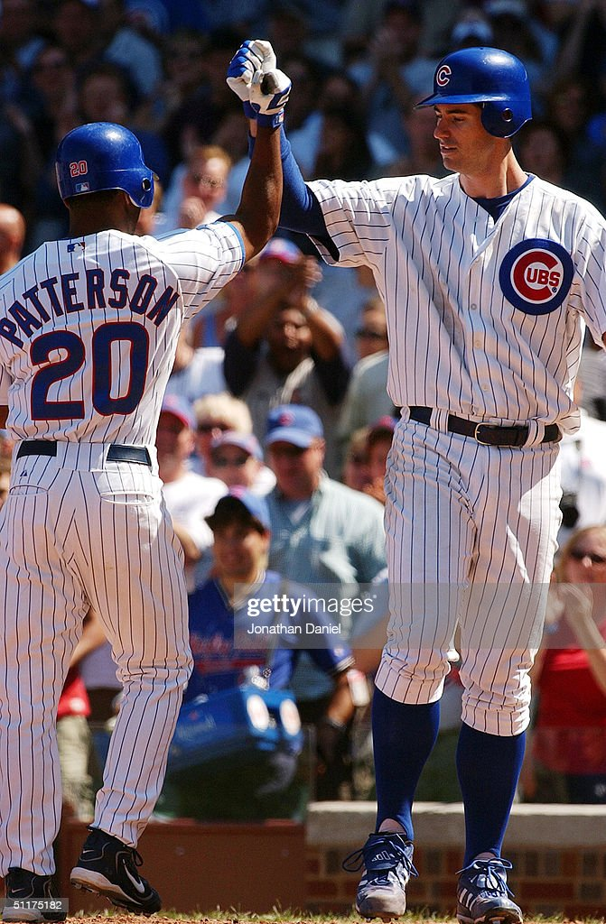 Mark Prior #22 of the Chicago Cubs greets teammate Corey Patterson #20 at the plate after Patterson hit a two-run home run in the fifth inning against the Los Angeles Dodgers during a game on August 15, 2004 at Wrigley Field in Chicago, Illinois. The Dodgers defeated the Cubs 8-5.