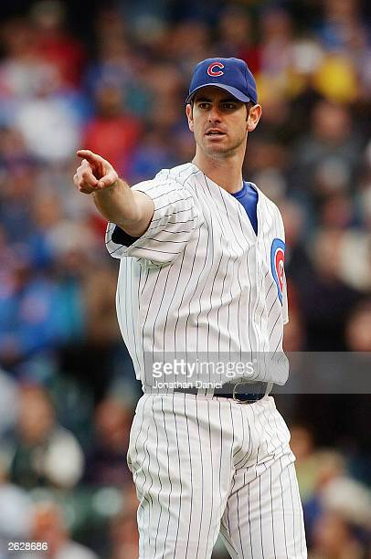 Mark Prior of the Chicago Cubs points against the Pittsburgh Pirates during the first game of a double-header on September 27, 2003 at Wrigley Field...