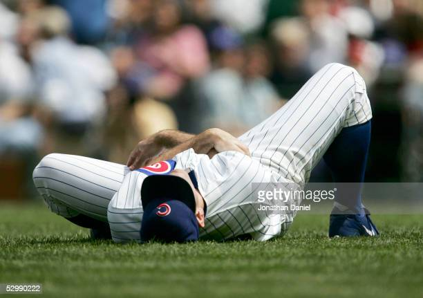 Mark Prior of the Chicago Cubs rolls on the ground after being hit on the arm by a line-drive from Brad Hawpe of the Colorado Rockies on May 27, 2005...