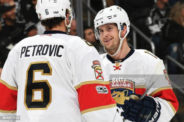 Mark Pysyk of the Florida Panthers chats with teammate Alex Petrovic before a faceoff during the game against the Los Angeles Kings on February 18...